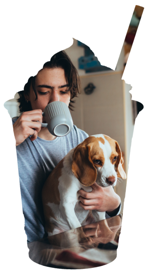 Man Drinking Coffee While Holding Dog